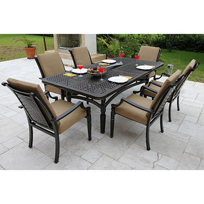 Oraville Woven Cast Patio Dining Set with Premium Sunbrella® Fabric - 7 pcs.