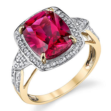 Lab Created Ruby Ring surrounded by .19ctw Diamonds in 14kt Yellow Gold
