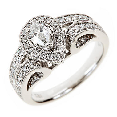 0.85 CT. T.W. Pear and Round Diamond Ring in 14K White Gold (I, I1)