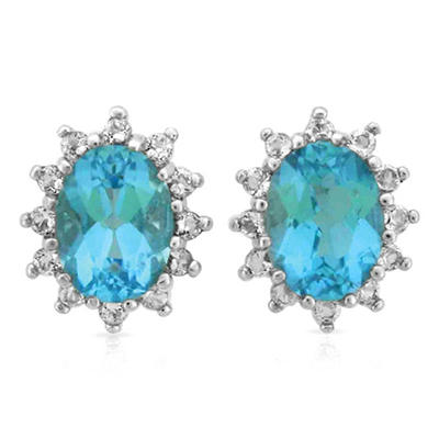 Oval Cut Blue and White Topaz Earrings in 14K White Gold