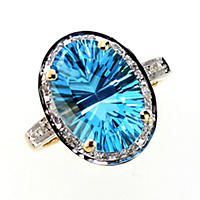 Oval Concave Cut Blue Topaz Ring with Diamonds in 14K Yellow Gold