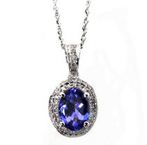 Click here for Oval Shaped Tanzanite with Diamond Pendant in 14K... prices