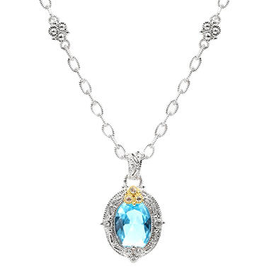 Judith Ripka's Estate Oval Blue Topaz Pendant in Sterling Silver