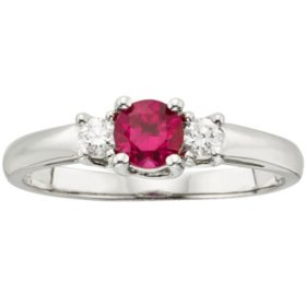 Three Stone Round Ruby Ring with 0.14 CT. T.W. Diamond Set in 14K Gold