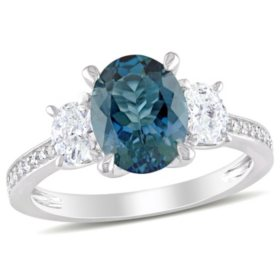 2.5 CT. T.G.W. Blue Topaz and 0.6 CT. T.W. Diamond Three-Stone Engagement Ring in 14k White Gold