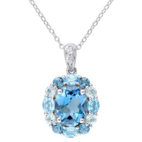 3.96 CT. T.G.W. London-Blue Topaz 0.48 CT. T.G.W. Sky-Blue Topaz and 0.8 CT. T.G.W. Swiss-Blue Topaz and 0.045 CT. T.G.W. White Topaz Cocktail Pendant in Sterling Silver
