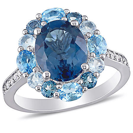 3.96 CT. T.G.W. London-Blue Topaz 0.48 CT. T.G.W. Sky-Blue Topaz and 0.8 CT. T.G.W. Swiss-Blue Topaz and 0.14 CT. T.G.W. White Topaz Cocktail Ring in Sterling Silver
