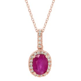 Genuine Ruby and 0.11 CT. T.W. Diamond Pendant in 14K Gold