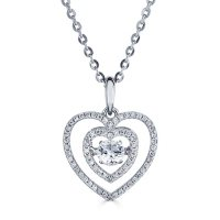 Sterling Silver Dancing Lab Created White Sapphire and 0.14 CT. T.W. Diamond Heart Pendant
