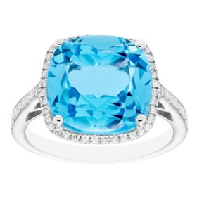 7 CT. Blue Topaz and 0.21 CT. T.W. Diamond Ring in Sterling Silver