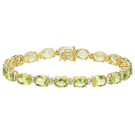 23 CT T.W. Oval Cut Peridot and Diamond Bracelet in 14 Karat Yellow Gold
