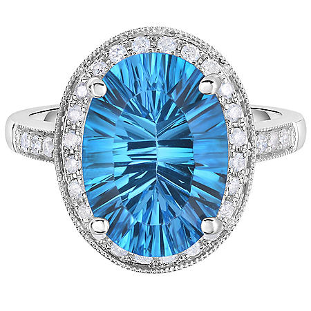 Oval Blue Topaz and 0.30 CT. T.W. Diamond Ring in 14 Karat White Gold