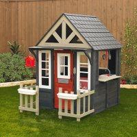KidKraft Lakeside Bungalow Wooden Playhouse with Working Doorbell, Fence, Kitchen and Pet Door