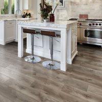 Select Surfaces Warm Gray Spill Defense Laminate Flooring